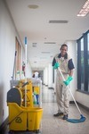 janitor mopping hallway